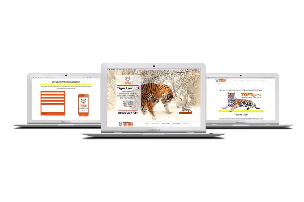 website mockup display showing site made by Here's the Cavalry on silver laptops