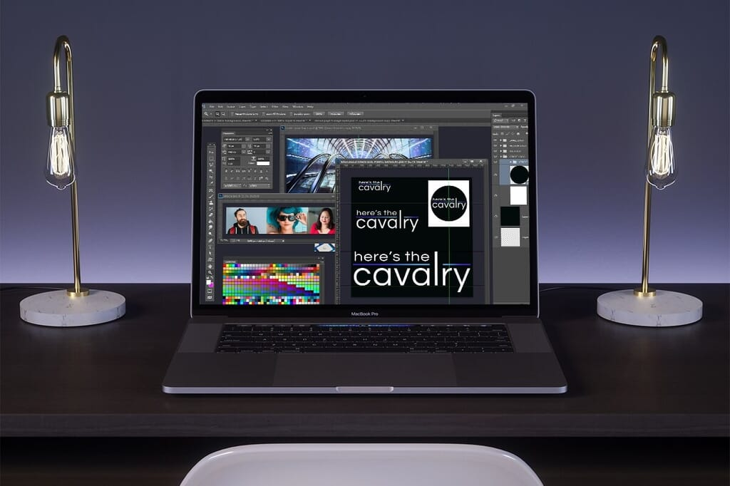 laptop showing open photoshop with here's the cavalry branding