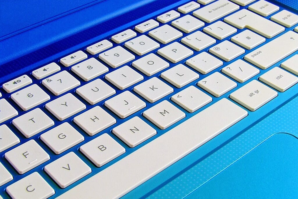 blue laptop with white keyboard