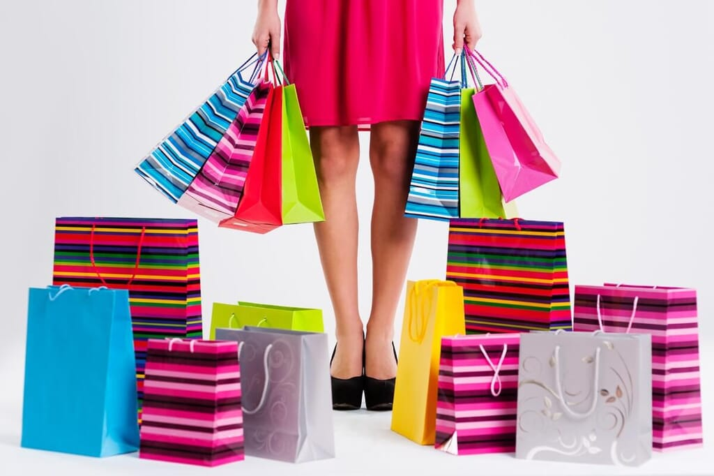 woman with brightly colored shopping bags and packages
