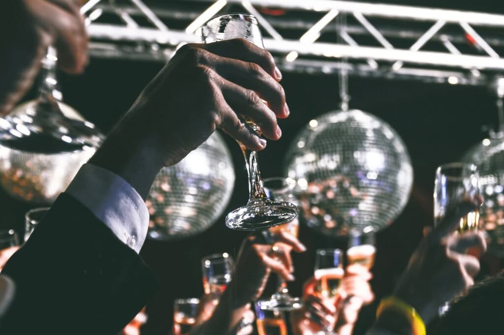 party guests raising champagne glasses
